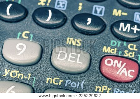 closeup fragment of delete button on vintage scientific calculator panel