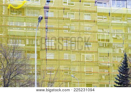 restoration of old big house under yellow net