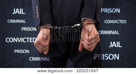 Jail convicted prison criminal labels with close handcuffed man