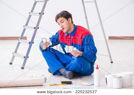 Young painter trying to match colors for painting job