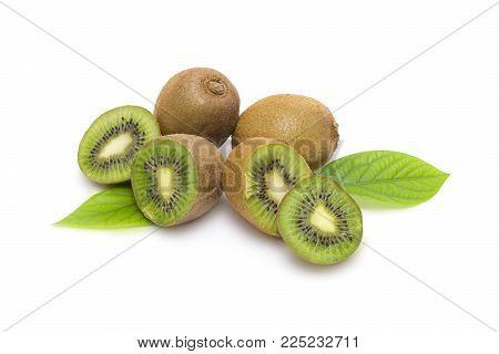 Kiwi on white background. Composition of kiwi on white background. Tropical fruits on a white background. Green kiwi in the group.