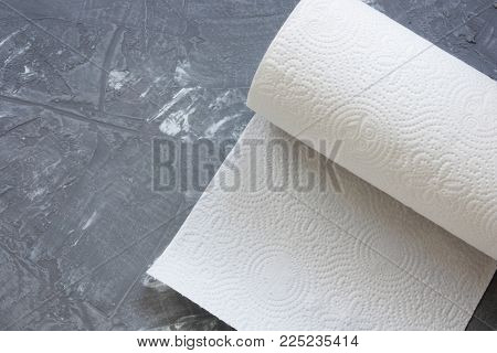 white paper kitchen towel on concrete table