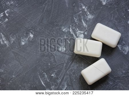 some soap pieces on gray concrete background