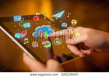 Female hands touching tablet with colorful social media icons