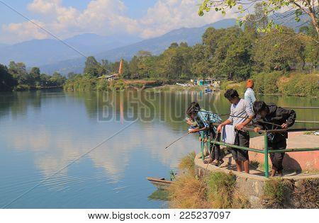 Pokhara Nepal - November 8, 2017: Unidentified People Fish At Dam Side Park In Pokhara Nepal.