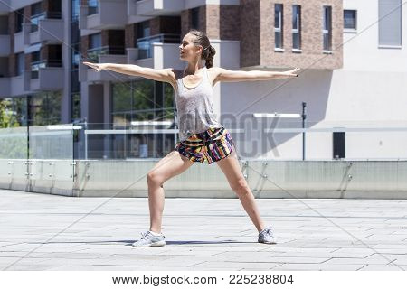 Young Fitness Female Runner Stretching Body  Before Run