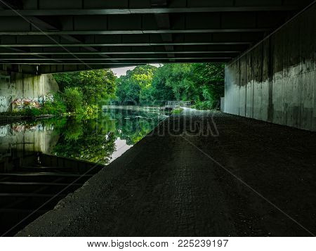 Under a Road bridge over a city canal in London