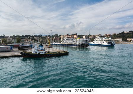 CORFU, GREECE - MARCH 5, 2017: Ferries in port of Corfu Island, Greece. Corfu town is one of the most romantic places in Greece.