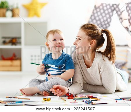 children's creativity. mother and baby son drawing together