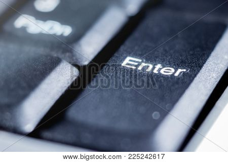 on the keyboard of the laptop - a close-up key to enter, a symbol for entering and storing information