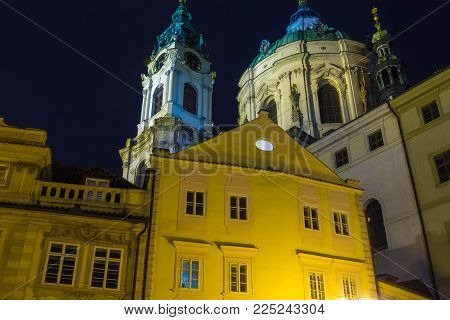 St. Nicolas Church in Mala Strana district of Prague, Czech Republic at night