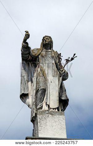MANTUA, ITALY - JUNE 04: Saint Catherine of Siena, statue on facade of the Mantua Cathedral dedicated to Saint Peter, Mantua, Italy on June 04, 2017.