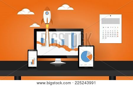 Rocket launch from PC monitor. PC monitor and tablet and smart phone width business chart on office desk. Concept of business start-up, boost or success