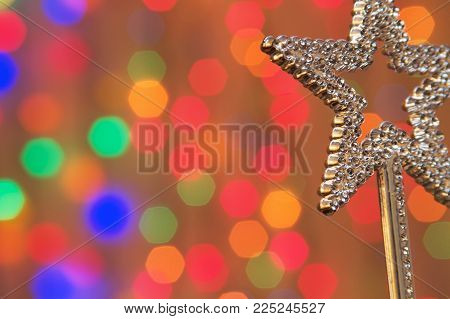 a magic fairy wand on bright background.