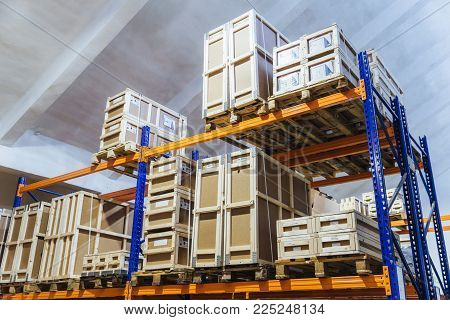 Large trucking warehouse. Wholesale store with cardboard boxes. Rows of shelves with paper containers. Large factory. Storehouse interior