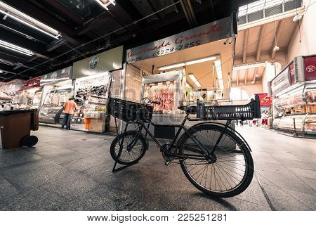 SAO PAULO, BRAZIL - FEBRUARY 02: Horizontal picture of stand bicycle in front of butchery at Mercadao, market place located in Sao Paulo, Brazil