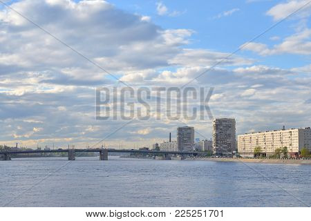 Volodarsky Bridge and Oktyabrskaya Embankment on outskirts of Saint Petersburg by day, Russia.