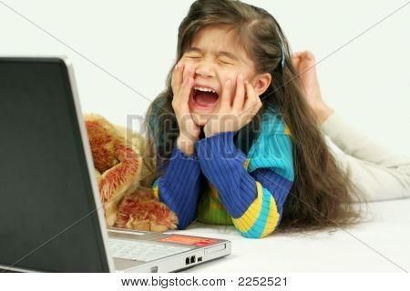 Five Years Old Enjoying Her Laptop, Laughing