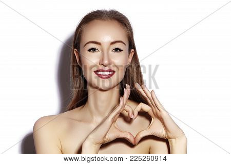 Romantic Young Woman Making Heart Shape With Her Fingers. Love And Valentines Day Symbol. Fashion Gi