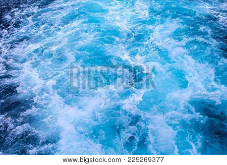 Natural surface water background. Sea ship trail with foamy wave. Tropical island cruiseliner travel. Motor boat seawater trail. Ocean top view. Big ship trail. White swirl wave in sea. Marine travel