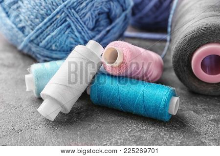 Colorful threads on grey background