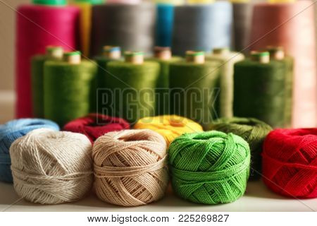 Set of color crocheting clews on shelf