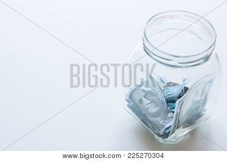 Glass Jar For Donations With Place For Text On A White Background