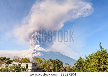 Early morning eruption of Fuego volcano next to Acatenango volcano near Antigua, Guatemala, Central America