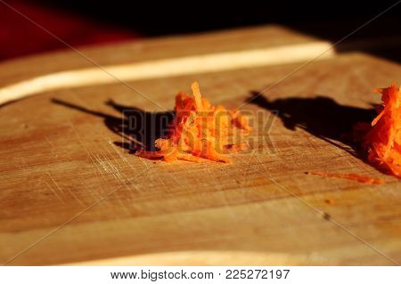 The Grated Carrot Creating A Small Pile