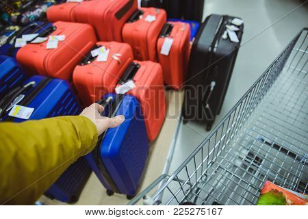 first person view man buy suitcase in the store