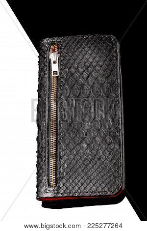 Long Wallet Of Black Crocodile Skin And Red Skin Inside.luxury Wallet.black And White Background