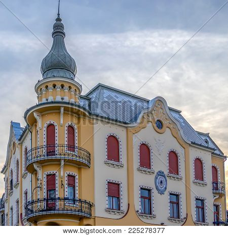 ORADEA, ROMANIA - JANUARY 27, 2018: The Poynar House was built in 1907 by Sztarill Ferenc. In secession style, the building is decorated with polychrome ceramic elements and floral plaster.