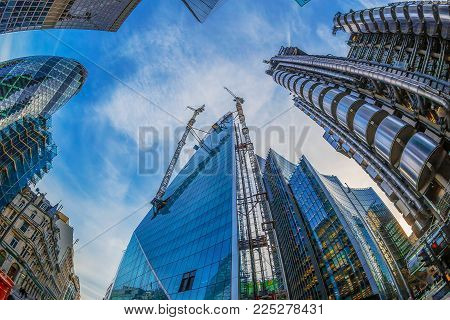LONDON, ENGLAND - NOVEMBER 27, 2017: Wide angle shot of skyscrapers in Central London, including the Lloyd's Building (also known as The Inside-Out Building),Gherkin tower and building in construction