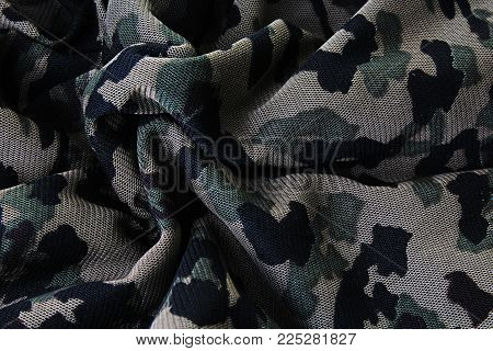 Military fabric closeup pattern texture as background. Macro cloth photo.