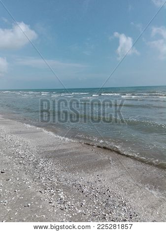 Waves On The Shoreline Of The Mediterranean Sea