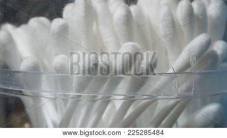closeup of white cotton bud or cotton swab in crack plastic box container