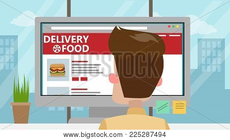 Businessman ordering food from computer in office.