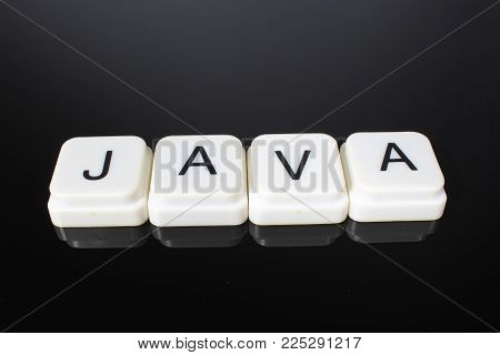 Java text word title caption label cover backdrop background. Alphabet letter toy blocks on black reflective background. White alphabetical letters..