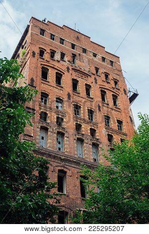 Abandoned factory of red brick - former elevator of factory of baked goods, Novorossiysk, Russia.
