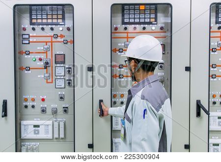 Engineer and  control and protection panel at power plant