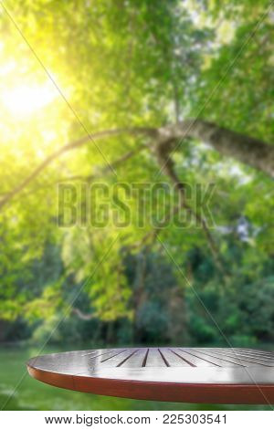 Empty Wooden Tabletop And Green Natural Spring Blur Bokeh Nature Background Use For Products Display