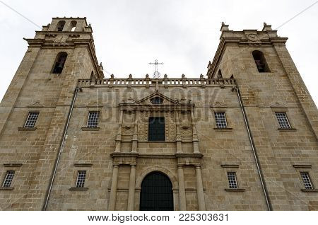 Close-up to the catholic cathedral of mannerist style with an austere facade flanked by imposed bell towers on each side and surmounted by rail, in Miranda do Douro, Portugal