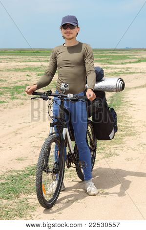 Bicycle Tourist Standing On Road, Blue Sky And Horizon
