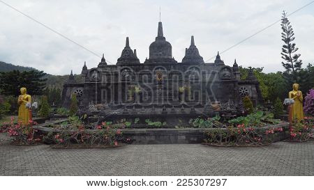 Buddhist temple Brahma Vihara Arama with statues of the gods on Bali island, Indonesia. Balinese Temple, old hindu architecture, Bali Architecture, Ancient design. Travel concept.