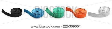 Set of karate belts on white background