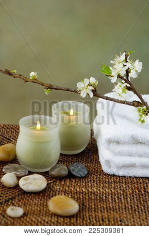 Spa resort with candle,stones , cherry flower,towel