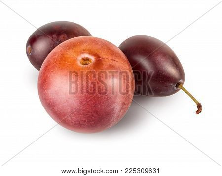 Cherry plum and two plums closeup with a green tail, isolated on white background. Freshly fruit, berry of plum.