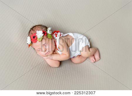 smiling newborn girl in Ukrainain national costume
