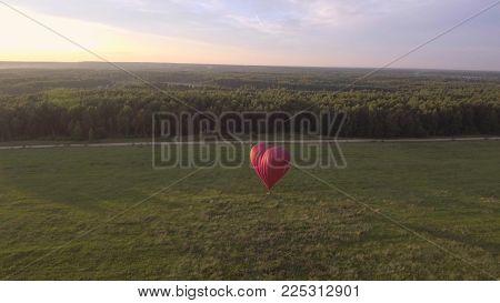Hot air balloon shape of a heart. Aerostat, Airship. Red balloon.