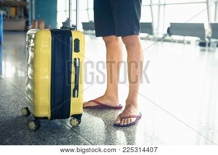 Man carries your luggage at the airport terminal of Hong Kong, after gonna fly to Singapore for business